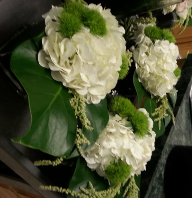 Flowers at RECon Las Vegas, Flower Description: Green dianthus with white hydrangea and tropical leaves